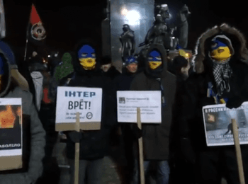 Euromaidan activists march in Kharkiv, guarded by Ultras (football fans)