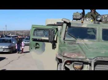 Russian troops and unknown civilian blocking Ukrainian miltary unit in Perevalne, Crimea