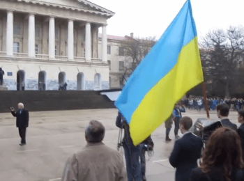 Students of the University of Sevastopol during lifting of the Russian flag defiantly left a parade-ground