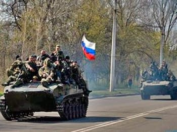 The column of armored vehicles drove under the Russian flag in the Slavyansk, on April 16, 2014