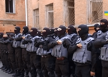 Soldiers of the battalion «Azov» say a prayer before going to the east of Ukraine
