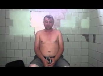 Soldiers of the battalion «Azov» interrogate the separatist