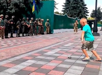 """Warriors of Light"" play football near Parliament, on July 3, 2014"