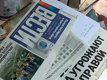 "Unknowns in masks was crushed an office of ""Vesti"" newspaper, on July 5, 2014"