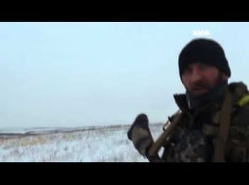 "Soldiers of the ""Azov"" battalion set a flag of Ukraine near Granitne"