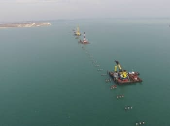 """Building"" of a bridge across the Kerch Strait (footage from a drone)"