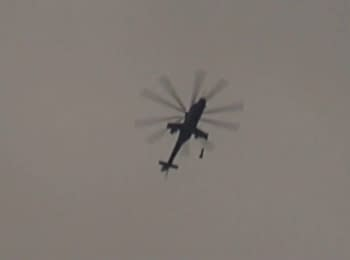 Military Mi-24 drops bombs on residential area, suburb of Daraya, Syria