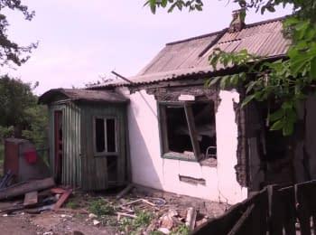 Последствия обстрела боевиками частного сектора города Торецк