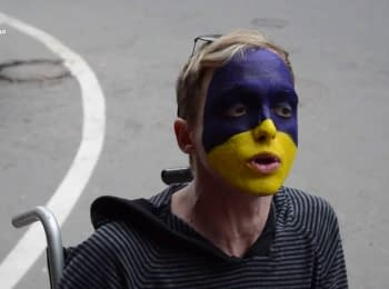 With the Ukrainian flag on the face
